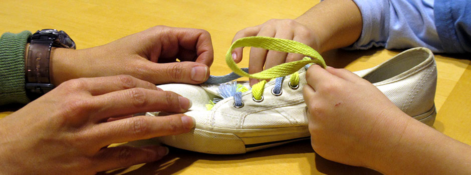Sensational Kids Therapy, Occupational Therapy in Washington DC, Child learning to tie shoes